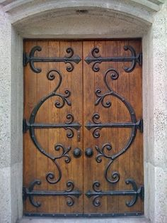 wrought iron and wood doors - Buscar con Google