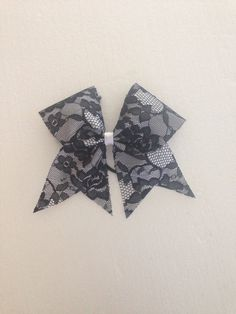 Black lace softball bow, on Etsy, $8.00, kinda into lace bows right now......don't know why.....they are just cute!!!