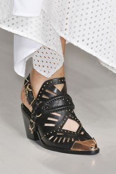 MARISSA WEBB: These cowboy inspired booties on the runway at Marissa Webb are about as cool as it gets.