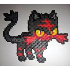 Litten (Pokémon) perler beads by peachiperlers Melty Bead Patterns, Pearler Bead Patterns, Perler Patterns, Beading Patterns, Pearler Beads, Hamma Beads Ideas, Pokemon Perler Beads, Anime Pixel Art, Pixel Art Templates