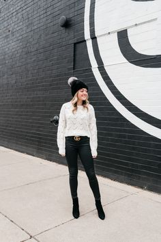 290288e226d62 Chicago lifestyle influencer Jessica Sturdy wearing a fur beanie with a pom  pom and a gucci