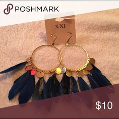 Feather earrings Blue feather earrings! Great for going out and adding that something to your outfit! The feather have gotten a little ruffled but other than that still cute! Forever 21 Jewelry Earrings