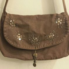 Brown really awesome purse Brown jean material! purse you can wear on the shoulder or across your body. Strap is adjustable to your likes!;) Bags Crossbody Bags