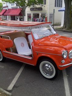 I could zip around the Hamptons in this! I love the monogrammed seat covers. I hope they are terry cloth. Wouldn't that be both darling and practical?