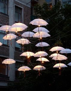 Not Your Average Umbrella: 5 Unexpected Ways to Use Umbrellas Outdoors...this is really cute but seems like you need a huge budget!