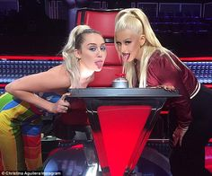 You do it like this: Christina Aguilera showed she's getting to grips with Miley Cyrus' si...