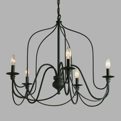 Our exclusive Rustic Wire Chandelier features a slender silhouette inspired by vintage French chandeliers. With five antique gray candelabra sockets and a matching canopy, this chandelier exudes a rustic grandeur when hung above the dining table.