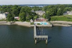 A private pier in the back juts out into the Long Island Sound and can accommodate a  yacht up to 200 feet long.