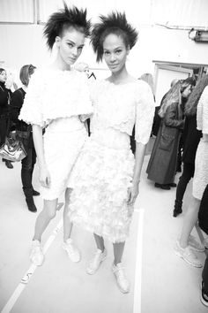Models Kati Nescher and Joan Smalls backstage at Chanel Couture Spring/Summer 2014