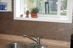 Lyric Penny Tile in Build from MosaicTileSupplies.com on a residential kitchen backsplash