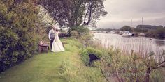Bride and Groom next to Wareham River at The Priory Wareham wedding. Photography by one thousand words wedding photographers