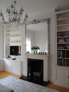 Over mantle mirror and bespoke shelving & cupboards.