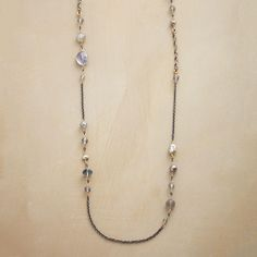 """INTERSTELLAR NECKLACE--Dana Kellin builds bridges to the stars from 14kt gold filled bars crisscrossed with sterling silver wire. """"Planets"""" include labradorites, moonstones and cultured silver pearls. Lobster clasp. Handmade in USA. Approx. 40""""L."""