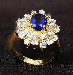 Jackie's sapphire and diamond ring was set with a large oval sapphire and tapered baguette and round diamonds.