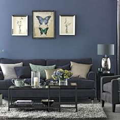 And there are also other choices for a cooler look. Here, it's grey. There are grey walls, and not even the lightest shade. Plus there's a denim sofa and a steel and glass table.