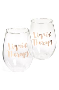 """Gift Ideas Under $25. Gilded wine glass that says """"Liquid Therapy."""""""