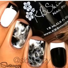 This is an awesome marbling.  1. Paint nail white 2. Drop a few big nail polish drops onto the nail.  3. Then rub a piece of plastic into the nail.  4. Clean up the mess around the nail  5. Done!
