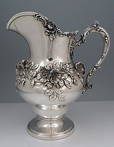Antique sterling silver pitcher by Graff Dunn and Washbourne with cast and applied floral decoration. Antique sterling silver pitcher by Graff Dunn and Washbourne with cast and applied floral decoration. of two pins] Cles Antiques, Vintage Silver, Antique Silver, Vintage Green, Argent Antique, Silver Water, Bronze, Silver Spoons, Tea Pots