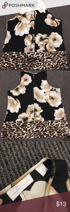 NY&Co Floral/Animal print Top Great choice for your workday! Blouse from NY&Co, size Large. Excellent condition! Keyhole detail in the front, metallic buttons on the back and a slight ruffle detail along the bottom. Smoke free, pet free home New York & Company Tops Blouses
