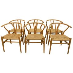 The Wishbone Chair (CH24) by Hans Wegner   From a unique collection of antique and modern dining room chairs at http://www.1stdibs.com/furniture/seating/dining-room-chairs/