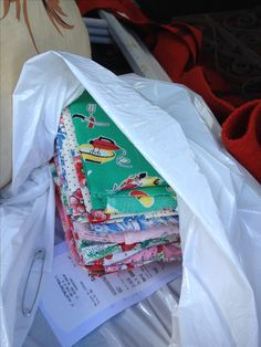 A bag of adorable vintage fat quarter fabrics. Can use making pillows.