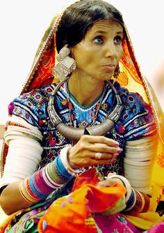 Kutchi tribal woman.just look at the earings.so heavy!!!