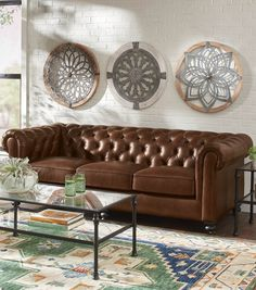 Available in rich microfiber velvet colors exclusive to Grandin Road, or supple top-grain leather, the London Sofa's timeless Chesterfield design is masterfully tufted and upholstered by hand. But it's highly durable and made for active living. Go ahead… put your feet up.