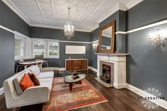 White trims and skirting boards show where the walls meet the floor and highlight the fireplace. Noguchi Coffee Table, Skirting Boards, Real Estate Photography, White Trim, Grey Walls, Lounge, Flooring, Colour Contrast, Creative