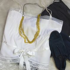 Betsey Johnson White Lace & Satin Bow Cami To all my girly-girls, spend your sun-shiny Summer days in this sweet cotton and lace cami by our pal Betsey J. Stay cool and look divine with those scalloped or Pom Pom shorts we know you have. Big floppy hat? Yes! Chuck Taylor's or Espadrilles? Abso-flippin-lutley. Sunscreen? A skin saving must! Warm weather Romance? That's your call. Personally I prefer my dog but You do you. (Gently worn. Fantastic condition.) Betsey Johnson Tops Camisoles