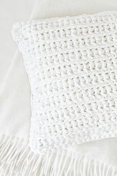 I wish I could find this exact pillow in sweater form. Every year I wear white woolen sweaters. This is a pillow I should add to home decor. I hate doing so without giving the price etc.