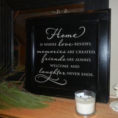 Home is where love resides - Black with Cream sign on reclaimed wood