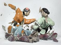 At the point of impact: Visceral, violent photographs of fighting porcelain figures | Dangerous Minds
