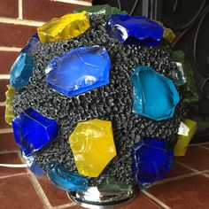 These Illuminated Chunky Glass Mosaic Sculptures are   handmade by California artist Troy Boepple. Each piece of glass is hand cut from hand poured slabs of glass, also know as Dalle de verre. Each piece is then chiseled by hand to give them their unique shape and texture. These illuminated sculptures are available in a combination of glass and metals or glass and resins. It takes more than 40hrs to create the larger sculptures.