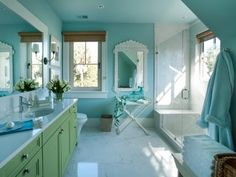 A turquoise wall color sets the scene for interior design in one of HGTV Dream Home's most exquisite spaces. Carrera marble and mother of pearl are among the room's most outstanding features.