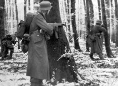 Battle of the Bulge.  German soldier by the tree is holding an STG44.  Great gun.