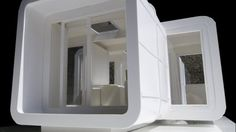The Sliding Hub prefabricated cubes join together to create a temporary housing solution f...