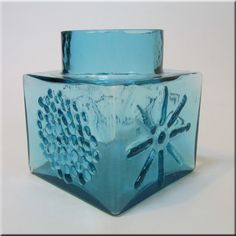 Dartington British kingfisher blue glass vase with moulded stylised flower and sun patterns, designed by Frank Thrower, pattern number FT2.