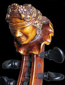 The Viola D'amore- always featuring the the blind-folded head of a Cherub, because afterall love is blind...
