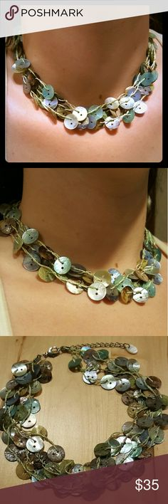 Multi Strand Abalone Button Necklace Beautiful choker style abalone shell necklace with multiple strands in various shades of green abalone button shells that add depth and dimension to this lovely piece. Measurements: pending. Jewelry Necklaces