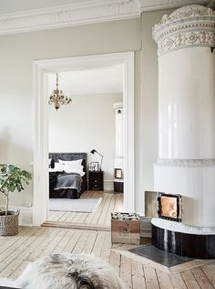 Holy white fireplace batman! This knocked my socks off. Incredible swedish apartment! | anders bergstedt photo
