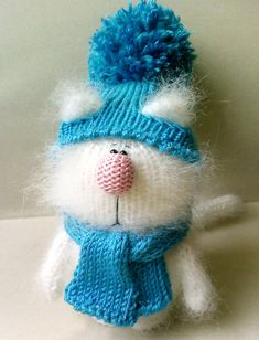 This little kitty is made of a soft and fluffy mohair. He came in a nice cap and scarf ( it can be removed). You can choose cats clothes of any color you want:) Cat has a sad emotion, you can also choose smile (just tell me) He stuffed with polyfil.    Нe is about 12 cm tall =4,7 inches    Welcome again to my Miracle Store. You will see a lot of novelties of my amigurumi toys soon:)  Thanks for looking