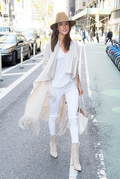 Alessandra Ambrosio might strut down the Victoria's Secret Fashion Show runway in skimpy lingerie and attend red carpets in formfitting dresses by designers like Balmain and Michael Kors, but in real life, that's not her style. The Brazilian supermodel reaches for comfy and loose pieces that fit her boho, relaxed style (and busy life as a mom of two) for everyday wear, putting together outfits worthy of the best street style Instagram stars.