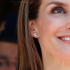 Queen Letizia wore her hair down and opted for her trademark front braid twist which showed off her Chanel 'Comete' diamond star stud earrings. The 18k white gold studs have a star-within-a-star design with 6 diamonds each.
