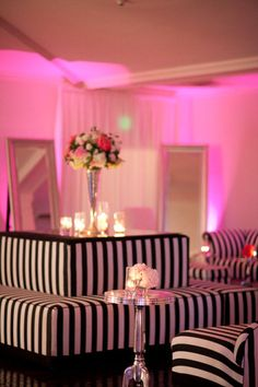 Pink, black, and white lounge.
