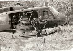 Soldiers of the 327th Infantry Regiment debark from helicopters