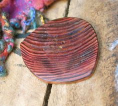 002 Dark red colored, large and freely shaped sequoia wood button, handmade, one of a kind, four holes di Piluck su Etsy