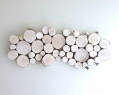 The white birch forest wall art is handmade using Maine white birch trees. Each branch is cut to size, carefully drilled and secured within the pine frame. The adorable dow and fawn are made out of pine wood. Two keyhole hangers are drilled on the back for easy installment. You will receive a similar item shown in the photo. Size: 12 x 12x3.5  Shipping: USPS  Explores our shop! https://www.etsy.com/listing/89177492/white-birch-forest-wall-artshelf-18x12?ref=relat...