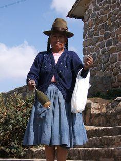 Lady spinning wool, Peru