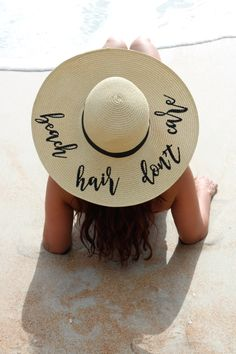 Imagine sitting at the beach with a good book,a refreshing drink and the smell of the ocean surrounding you. This custom embroidered beach hair dont care floppy sun hat says you are on vacation with nothing to worry about!  This paper blend natural colore