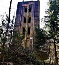 Hidden in a forest, forgotten in time, lies a fake 'city' - one of the last remains of Hitler's dream of the world capital 'Germania', Four buildings // towers, each 20 meters high, built of reinforced concrete that served as a test site for testing both bombs and construction, materials and types of buildings to build bomb-proof homes for civilians in Germania. #whitehouses #WorldWar2 #WW2 #german #Germania #Hitlers Nuclear Fallout Shelter, Bunker For Sale, Places Around The World, Around The Worlds, Bunker Hill Los Angeles, Bunker Hill Monument, Doomsday Bunker, Derelict Buildings, Bomb Shelter